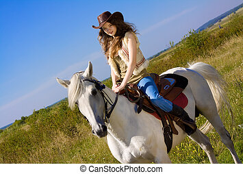 young cowgirl on white horse