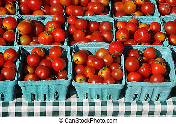 Tomatoes at Farmers Market - cherry tomatoes in little...