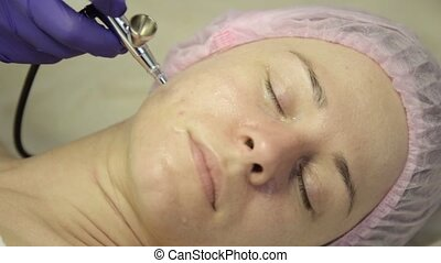 beautiful woman getting a cosmetic medicine treatment....