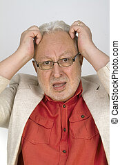 White haired senior with glasses tearing his hair - on...