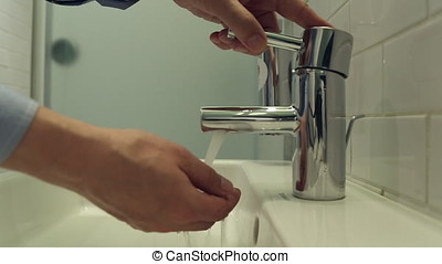 Man washes his hands with soap