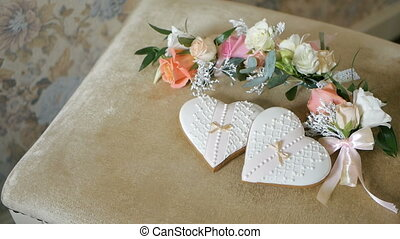 cookies in the shape of hearts, wedding boutonnieres flowers
