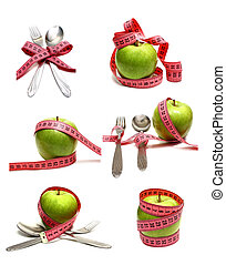 spoon fork and apple is strung by a ribbon for measuring...