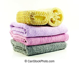 loofah shower and towel isolated on white background