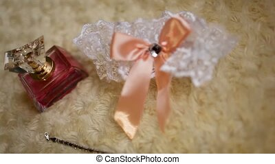 wedding garter white with lace lies on the bed