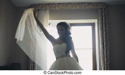 Happy brunette bride dancing. Attractive woman in wedding...