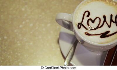 Coffee latte art, love heart symbol - Coffee cappuccino art,...