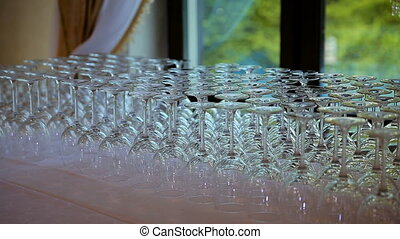 Glassware macro close up. Rims of empty glasses set for sparkling wine prepared to be poured on festive night celebration birthday anniversary or wedding - changing focus shallow depth of field