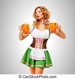 Serving with smile. - Beautiful Oktoberfest woman wearing a...
