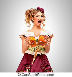 Beer and toast. - Beautiful Oktoberfest waitress wearing a...