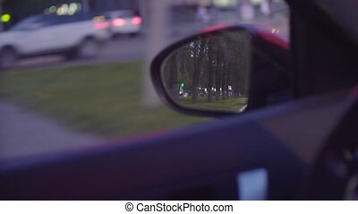 View of the city traffic in car's rearview mirror