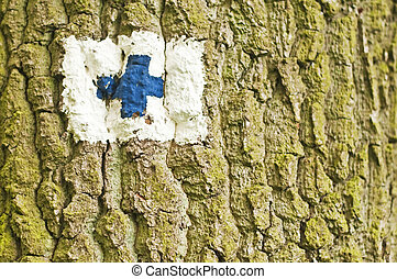 direction sign on a tree