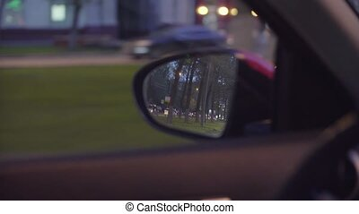 View of the city traffic in car's rearview mirror - Point of...