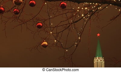 Moscow is decorated for New Year and Christmas holidays. Christmas balls on the branches of trees near the Cathedral of St. Basil the Blessed on Red Square. New Year theme.