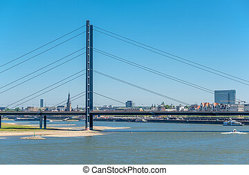 Dusseldorf city cityscape with bridge Rhine with river in...