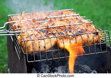 grilled chicken in barbecue grate