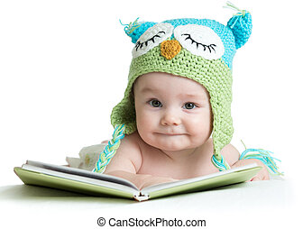 baby infant in funny owl knitted hat owl with book on white background