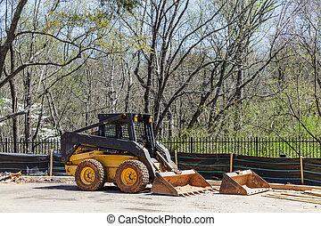 Front End Loader at Silt Fence on construction site