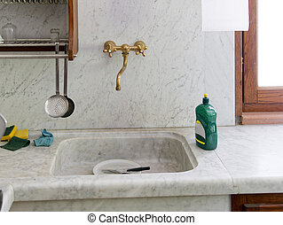 detail of marble sink in a galley