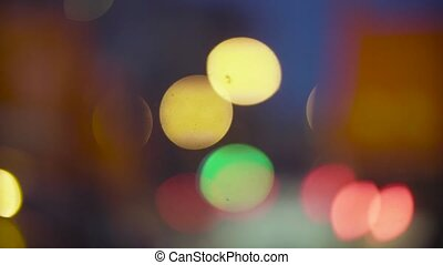 Defocused traffic lights at night in Moscow.