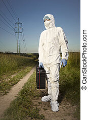 Technician in fields dressing protective equipment -...