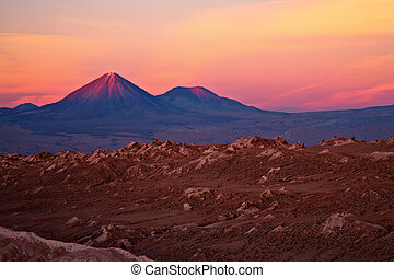 sunset over volcanoes Licancabur and Juriques, Atacama...