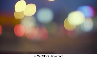 Defocused traffic lights at night in Moscow. 4K. Out of...