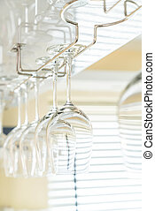 Wine's glass hanging on bar. - Selective focus point on...