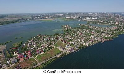 Aerial shot of the Dnipro river and Kherson city embankment