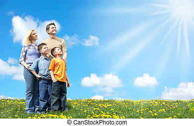 Happy family - Family under blue sky. Father, mother and...