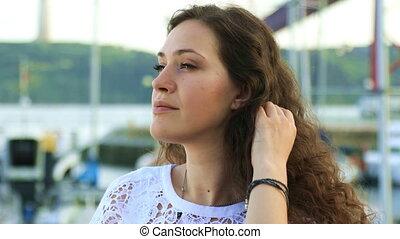 Pretty brunette smiling at camera - Portrait of pretty...