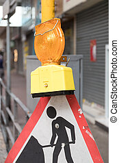 Road Works Sign With Light at Street