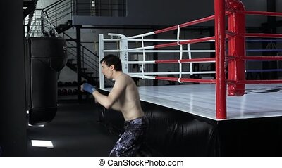 Handsome masculine athlete boxer mma fighter training. Man...