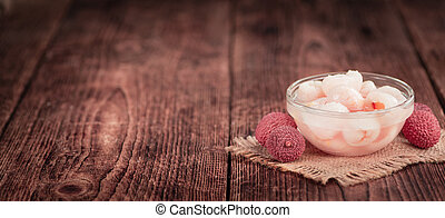 Preserved Lychees (selective focus) on vintage wooden...
