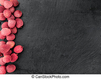 Portion of Lichee Fruits (selective focus) - Lychees on a...