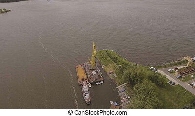 Aerial view:River port with cranes and ships.
