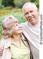 elderly seniors couple - Happy elderly seniors couple in...