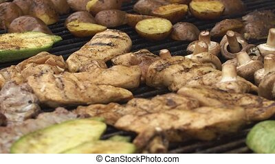 Meat and potatoes fry on the large pan