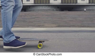 Foots of young man riding on longboard - Slow motion Close...