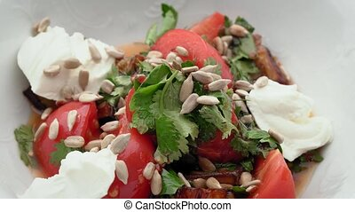 Eggplant salad with sunflower seeds and cheese and tomatoes...