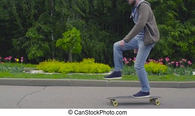Young man riding on longboard - Slow motion young man riding...