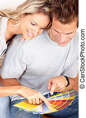 Renovation - smiling couple choosing color for the interior...