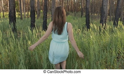 Girl with a bouquet of wild flowers in the forest - Girl in...