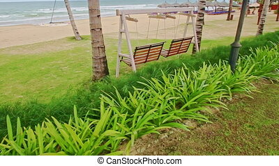 Park with Grass and Swing Benches by Ocean Sand Beach -...