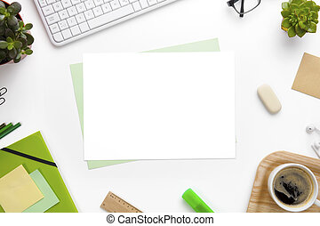 Blank Pages Surrounded With Office Supplies On White Desk -...