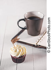 Fathers day concept. Delicious creative cupcake, tie on table.