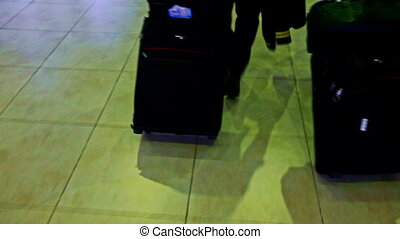 Closeup Large Black Suitcases Pulled on Marble Floor in Airport