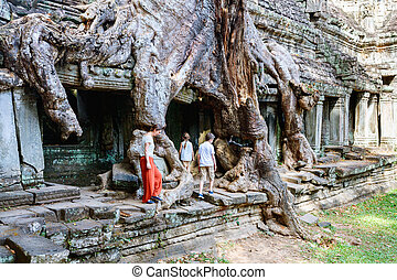 Preah Khan jungle temple - Family mother and kids at ancient...