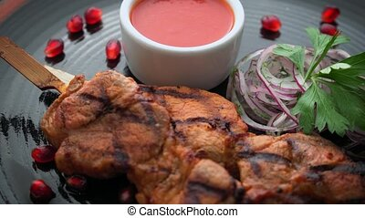 Skewers of meat with onions and sauce - Skewers of meat with...