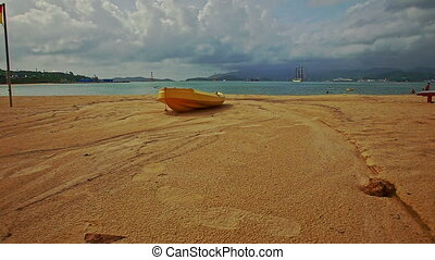 Wooden Boat on Sand Beach against Sea Islands Cloudy Blue...